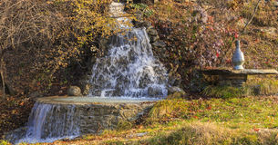 Waterfall and the ancient vessel for water transfer.Village Vand Royalty Free Stock Images