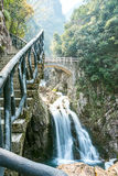 The waterfall and Arch bridge Royalty Free Stock Photos