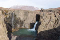 Waterfall. And arctic landscape in a rocky environment on Disko Island in Greenland Royalty Free Stock Photo
