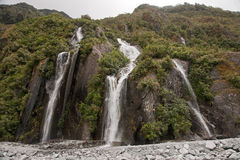 Waterfall in the area Frantz Josef Glacier Royalty Free Stock Image