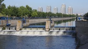 Waterfall. Arranged on the river that crosses the city stock video footage