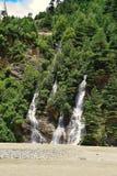 A waterfall as seen from Uttarkashi-Gangotri Highway, Uttarkashi, India. During monsoon, Uttarkashi-Gangotri Highway becomes more beautiful because of running Royalty Free Stock Photos
