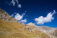 Waterfall in Austrian Alps Mountains. And deep blue sky Stock Photography
