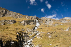Waterfall in Austrian Alps Mountains. And deep blue sky Stock Photos