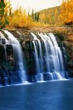 Waterfall in autumn Stock Images