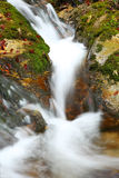 Waterfall in Autumn. Scenic view of rocky waterfall in autumn with slow motion blur Stock Image