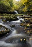 West Burton Portrait. A waterfall in autumn in the Dales National Park Royalty Free Stock Image