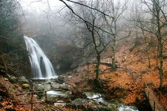 Waterfall in autumn forest Stock Photography