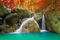 Waterfall in autumn forest. Royalty Free Stock Photos