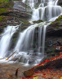 Waterfall in the autumn forest Royalty Free Stock Image