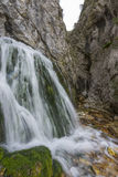 Waterfall in autumn in the forest, mount Cucco NP, Umbria, Italy Royalty Free Stock Image