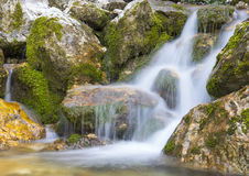 Waterfall in autumn in the forest, mount Cucco NP, Umbria, Italy Royalty Free Stock Photos