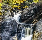 Waterfall in autumn forest Stock Photos