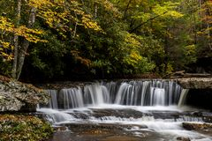 Waterfall in Autumn - Mash Fork Falls, Camp Creek State Park, West Virginia. A scenic view of Mash Fork Falls in the autumn / fall at Camp Creek State Park in stock images