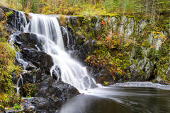Waterfall in autumn. A waterfall in Minnesota during Indian summer Royalty Free Stock Image