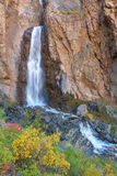 Waterfall in the autumn mountains Stock Photos