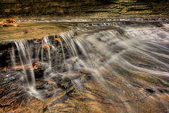 Waterfall In Autumn. One of the many scenic waterfalls along the Sulpher Springs Creek in Ohio . Located in the South Chagrin Reservation Cleveland Metroparks royalty free stock photo