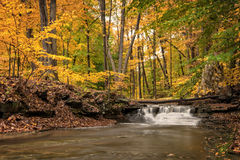 Waterfall In Autumn. One of the many scenic waterfalls along the Sulpher Springs Creek in Ohio during peak fall colors. This small waterfall looks it's best with royalty free stock photo
