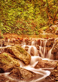 Waterfall in the autumn park Stock Photo