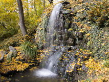 Waterfall in the autumn park royalty free stock images