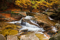 Waterfall in Autumn Scenery Stock Photo