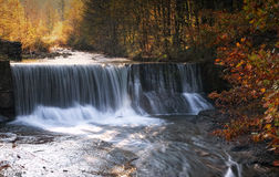 Waterfall in Autumn. Waterfall in the stream in the forest Stock Photo
