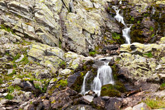 Waterfall background. Waterfall over rocks in motion in Rila mountains Royalty Free Stock Photos