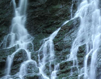 Waterfall background. Falling water captured with slow shutter speed to create blurred effect Stock Photos