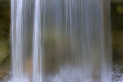 Waterfall background. Falling water with sprays and foam in blurred motion due to slwo shutter speed Royalty Free Stock Photography