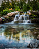 Waterfall. In background with soft still water in the foreground Royalty Free Stock Photos