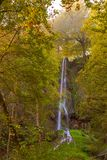 Waterfall in Bad Urach in autumn. The Uracher Wasserfall waterfalls near Bad Urach in autumn Royalty Free Stock Image