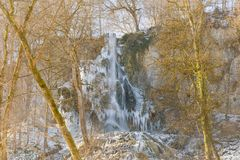 Waterfall in Bad Urach in winter. The frozen Uracher Wasserfall waterfalls near Bad Urach in winter at cold temperature Royalty Free Stock Images