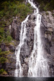 Waterfall on the bank of Lysefjorden in Norway Royalty Free Stock Images
