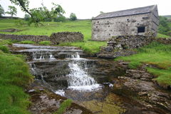Waterfall and barn royalty free stock photos