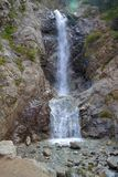 Waterfall. Barscoon waterfall in mountains of Kyrgyzstan Stock Photo