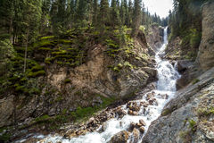 Waterfall Barskon in mountains of Tien Shan Stock Photography