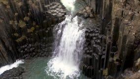 Waterfall and basalt columns. Litlanesfoss, Iceland stock footage