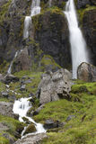 Waterfall and basaltic rocks. Iceland. Seydisfjordur. Stock Photos