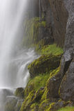 Waterfall and basaltic rocks. Iceland. Seydisfjordur. Waterfall and basaltic rocks in Seydisfjordur, Iceland Stock Images