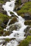 Waterfall and basaltic rocks in Iceland. Royalty Free Stock Photo