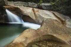 Waterfall at The Basin granite pothole, White Mountains, New Ham Stock Image