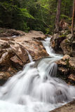 Waterfall at The Basin. River flows down rocky bed creating Waterfall flowing over rocks in The Basin New Hampshire on a summer day royalty free stock photo