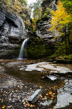 Waterfall Bathed in Autumn / Fall Colors - Eagle Falls at Havana Glen - New York. A scenic view of Eagle Falls at Havana Glen bathed in autumn / fall colors in Stock Photos