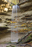 Waterfall in Bavarian forest. A beautiful view of a small waterfall in a Bavarian forest on an autumn day Stock Image