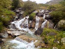 Waterfall. The beauitiful Waterfall in the mountains royalty free stock photo