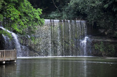 Waterfall. In a beautiful environment with a modern commercial and residential building Royalty Free Stock Photography