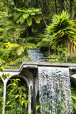 Waterfall in a Beautiful Garden at Monte above Funchal Madeira. This wonderful garden is at the top of the cablecar from the seafront in Funchal. It is filled Stock Photo