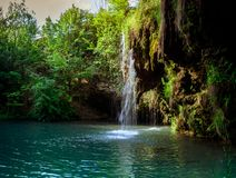 Waterfall and a beautiful lagoon lake for relaxing in the summer royalty free stock photo