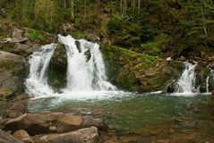 Waterfall. Beautiful waterfall in mountain forest Stock Images