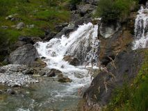 Waterfall. A beautiful waterfall over the mountains royalty free stock image